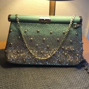 Sea foam green with gold accent purse.